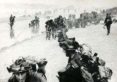 French and British soldiers regroup on Sword beach after the initial landing.