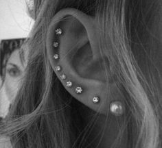 Professional top of the line helix ear piercing in the Washington, DC metro area. One of ladies favorite ear piercing! Great with tragus piercing and more. Ear Lobe Piercings, Types Of Ear Piercings, Multiple Ear Piercings, Body Piercings, Cool Peircings, Kylie Jenner Ear Piercings, Crazy Piercings, Different Ear Piercings, Piercing Tattoo