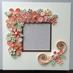 Quilled flowers for shadow box frame