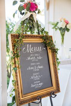 chalkboard wedding menu with a flower garland