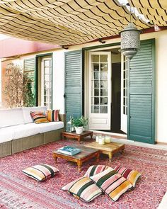 terrace idea; kind of Turkish design, short coffee tables, color green, cushions on the floor and definitely rug or carpet!