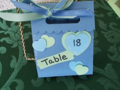 wedding favor/place card seats.  This is a handmade favor that includes a candy treat and a placecard marker all in one.  Can design with your color theme