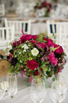 Round hot pink and green reception table centerpiece | floral design by http://www.hollychappleflowers.com/ | photography by http://www.timmesterphoto.com/
