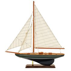 Collect model sailboats for a nautical touch in a space. | $63