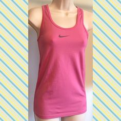 """Nike Dri Fit pink workout tank top Nike Dri Fit pink workout tank top. Beautiful shade of pink! Measures approx 27"""" long & 16"""" across chest. Very stretchy. Size medium. Only slight flaw is small snag on right side (last pic) otherwise in flawless condition. Check out my other athletic apparel & bundle to save!NO TRADESReasonable offers welcome using the offer button Nike Tops Tank Tops"""
