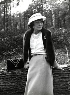 Coco Chanel out and about, wher would be without her? Love her style.