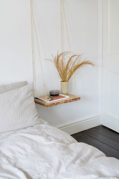 This DIY hanging nightstand will free up valuable floor space, making it a perfect solution for smaller spaces. Plus, it's also a great way to update your decor on a budget. Furniture, Craft Table Diy, Diy Nightstand, Diy Hanging, Diy Table, Floating Nightstand, Decorating On A Budget, Home Decor, Bedroom Night Stands