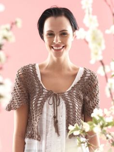 Free Pattern - A bolero with a four-leafed flower pattern featured on the back
