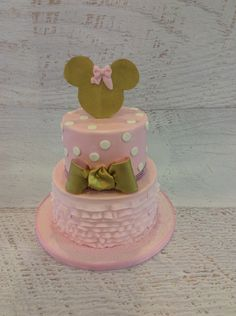 Pink and Gold Minnie Mouse first birthday party cake idea. For more ideas, follow A Pop of Party!
