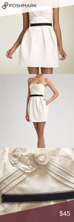 BCBG cream quilted embellished strapless dress Excellent used condition. Worn once then dry cleaned. Cream quilted and embellished sweetheart neckline, pockets and black empire waist belt. Gorgeous for rehearsal dinner, formal or other black tie affair! BCBGMaxAzria Dresses Mini