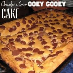 Pinner said: Paula Dean's Chocolate Chip Ooey Gooey Cake - I have made this twice now. It is super easy and people LOVE it! Made the ooey gooey butter cake Köstliche Desserts, Delicious Desserts, Yummy Food, Sweet Recipes, Cake Recipes, Dessert Recipes, Recipes Using Cake Mix, Dessert Bread, Bread Recipes