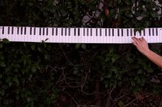Practice without a piano and hang this on your wall. Piano Key Wall Hanging DIY on the blog
