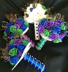 Peacock theme bouquets with wicker hearts as base. Added pearl and diamante detail on handle.  by Karen @ www.bouquetswithlove.co.uk https://www.facebook.com/Bouquetswithlove/