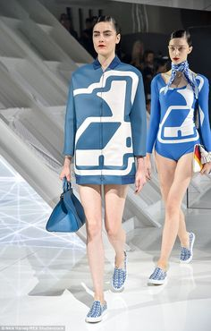 5a0ce613a9 Models stormed the runway in pumps and scarves with Mothercare's logo on,  as well as Nationwide jackets
