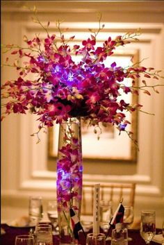 wedding centerpiece - like the purple color (perhaps have the glittered branches inside vase instead of more flowers?)