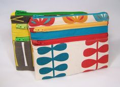 Love these - a colorful way to use up fabric scraps and all those odd zippers I've collected.