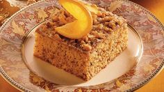 Looking for a tasty dessert? Then check out this orange cake packed with walnuts and raisins.