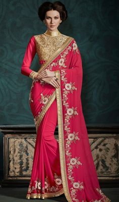 Discover elegance in this red color embroidered georgette saree. This wonderful attire is displaying some great embroidery done with resham and stones work. Upon request we can make round front/back neck and short 6 inches sleeves regular sari blouse also. #MindblowingDesignerWearSari