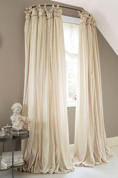 "The silky, billowing fabric suggests romantic nights in distant lands. The drapery panel is constructed to hang from either 14"" ties or 3"" ruched rod pocket and flows to the f"