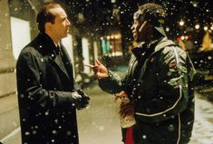 still-of-nicolas-cage-and-don-cheadle-in-the-family-man-(2000).jpg