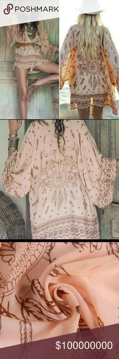 Skull Feather Kimono Beautiful Cool Boho Kimono in a peachy pink with cow skull detail on back. Great belted or open. Over swimsuit, with a tank and shorts or  just about anything. Made of Chiffon.  These run a little small.   Bohemian, Bull, Hippie, Western, Southwestern, Cover Up, Swim, Cardigan, Tribal, Dream Catcher, Feathers, Jacket, Cape, Wrap,  Price firm unless bundled Boutique Tops
