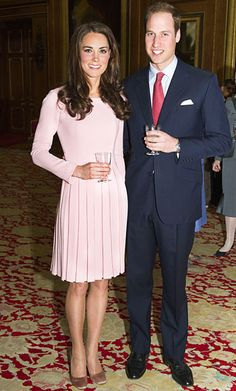 The Duke and Duchess of Cambridge mingled with royals from near and far for a luncheon celebrating the Queen's Jubilee at Windsor Castle. For the event, Catherine chose a rose pink dress by Emilia Wickstead, satin nude heels, and a Prada clutch.