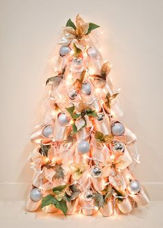 Do you decorate a tree at your studio? We would love to see it! #christmastree #tinsel #ornaments