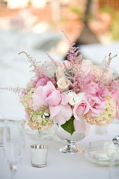 Short centerpieces. I hate it at weddings when I can't see over or around them because they are so tall and huge.