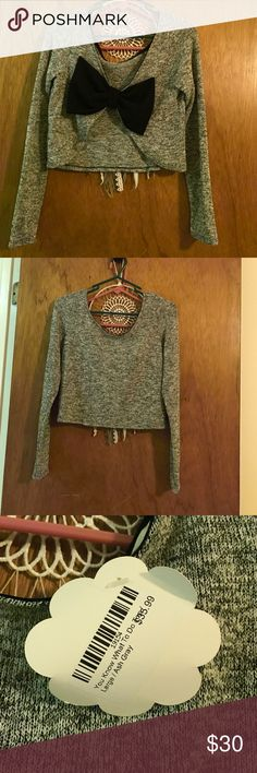 Crop top sweater with bow in back Never worn. Bought from Hope's (www.shophopes.com) new with tags Tops Crop Tops