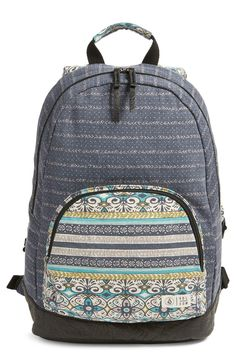 Heading back to school with this campus-classic backpack cut from durable canvas and equipped with plenty room to tote the books while looking stylish.
