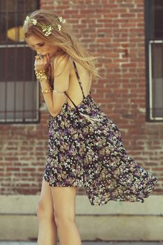 Loose free fitting floral dress with gold bracelets and real flowers in your hair x