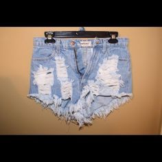 Vintage high waisted destroyed denim shorts Super cute destroyed blue jean shorts!! Match it with a top or a bathing suit!! Vibrant MIU Shorts Jean Shorts