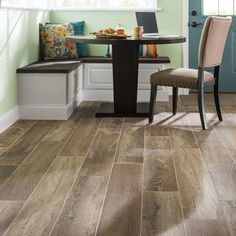 """""""Considering updating your flooring? Here, 48-in planks of glazed porcelain tile offer the look of real wood. #Lowes #PorcelainTile #Flooring"""""""