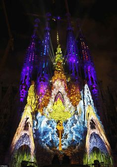 The Basilica Sagrada Familia is illuminated during the