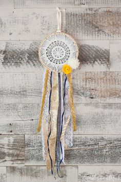 Create a beautiful feminine and rustic ribbon doily dream catcher using up your old ribbons stash! The perfect piece of precious DIY decor that's also a great gift idea!