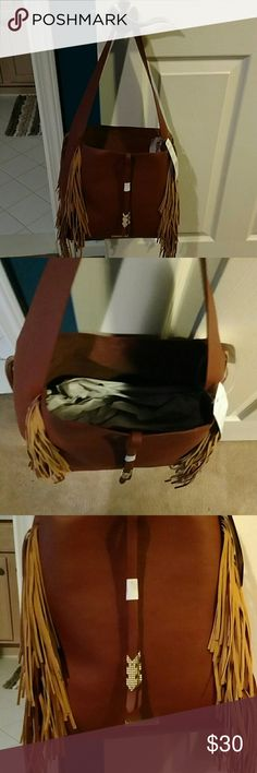 Purse Nubuck color with fringes on the side. A tassels down the front with gold arrows. Madden Girl Bags Shoulder Bags