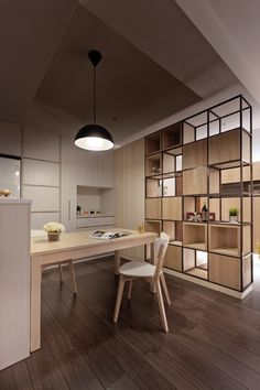 Kitchen Interior Design A closer look at the kitchen reveals elegant dining chairs and sleek hardware-free cabinetry. A single black pendant light hangs above. - Gallery featuring images of the gorgeous natural wood filled Xiaos house by PartiDesign. Office Room Dividers, Fabric Room Dividers, Decorative Room Dividers, Sliding Room Dividers, Room Divider Shelves, Space Dividers, Dividers For Rooms, Bookcase Shelves, Sliding Door