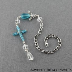 Blue Beach Glass and Clear Crystal Rear View Mirror Angel and Cross Rear View Mirror Charm Cross Car Charm Car Accessories For Women by SweetRideAccessories on Etsy https://www.etsy.com/listing/272475730/blue-beach-glass-and-clear-crystal-rear