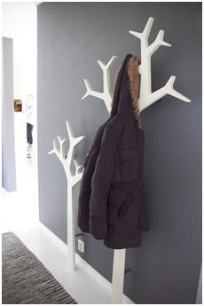Love the coat rack, but there are some other good organization/storage ideas too...