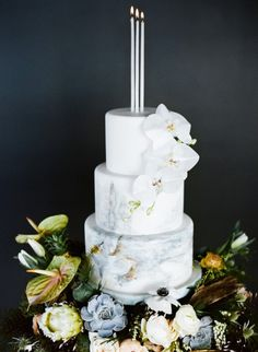 Marbled wedding cake with candle cake topper | Carrie King Photography on @burnettsboards via @aislesociety