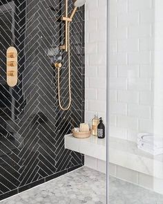 Chic black & white bathroom with marble hex floors.