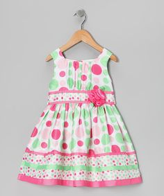 This delicacy of a dress boasts sheer fabric at the hemline and a playful polka dot print that can't be missed. A sweet band of ribbon at the waist sends this party-ready piece off the style charts!100% polyesterMachine wash; tumble dryImported