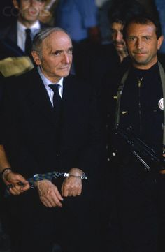 Nazi War Criminal Klaus Barbie's Trial - 0000227948-002 - Rights Managed - Stock Photo - Corbis. Klaus Barbie, who was the SS officer in charge of the Gestapo in Lyon, leaves the Lyon Law Courts where he has just been tried for his crimes against humanity during World War II. July 03, 1987