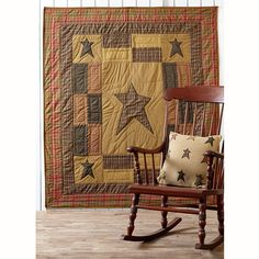 "The Stratton Quilted Throw measures 50""x60"". The throw is quilted with stitch in the ditch quilting with patchwork details and appliqued stars in tan, olive, reds and black and a 3.25"" rod pocket for display purposes. Price: $50.00"