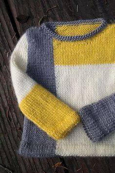 Tejidos - Knitted 2 - Ravelry: - De Stijl pattern by Stephanie MasonBaby Knitting Patterns Modern Ravelry: # 33 - The Style pattern by Stephanie MasonA modern color blocked sweater that is made from the bottom up in flat pieces and seamed. Kids Knitting Patterns, Baby Sweater Patterns, Knit Baby Sweaters, Knitting Designs, Baby Patterns, Knitting Projects, Crochet Patterns, Knitting Sweaters, Baby Sweater Knitting Pattern