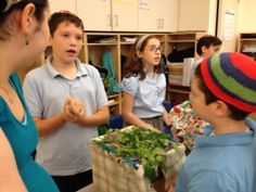 Students shared their model sukkot with 4th grade.