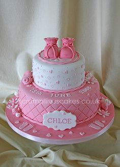 ff07f50bed64 Hot pink Christening Cake with girl baby shoes topper
