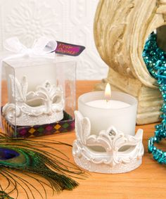 Mardi Gras Masked Theme Candle Votive- Bring the mystery, allure and vibrancy of the Mardi Gras into your next event with a stunning candle votive mask! Enchant your guests with a wild and romantic ambiance at your next event. This stunning gift will Candle Wedding Favors, Candle Favors, Wedding Party Favors, Votive Candles, Glass Votive, Wedding Centerpieces, Party Favours, Wedding Crafts, Wedding Themes