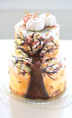 White two tier square autumn leaves wedding cake decorated with