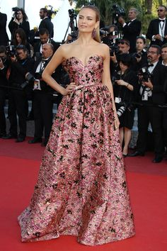 17 May Natasha Poly looked pretty in a pink brocade Prada dress.   - HarpersBAZAAR.co.uk
